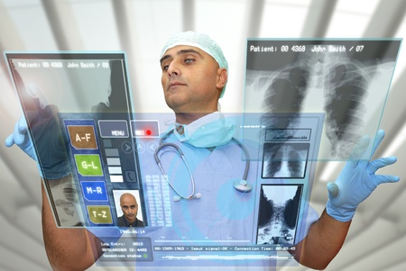 Foto de Doctor with hightech computer screen viewing patient data - Imagen libre de derechos