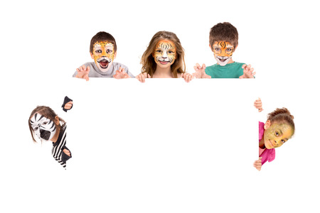 Photo for Children's group with face-paint over a white board - Royalty Free Image