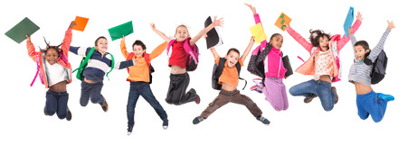 Photo pour Group of school children jumpng isolated in white - image libre de droit