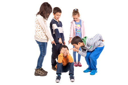 Photo for Group of children bullying an isolated child - Royalty Free Image