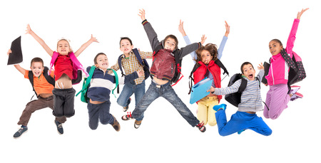 Photo pour Group of school children jumping isolated in white - image libre de droit