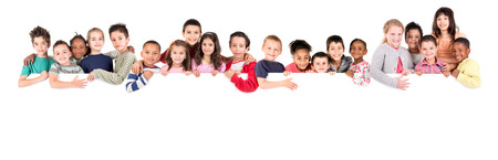Foto de Group of children with a white board isolated in white - Imagen libre de derechos