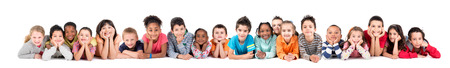 Foto de Large group of children posing isolated in white - Imagen libre de derechos