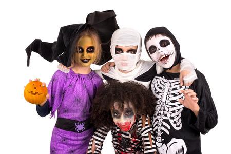 Foto de Kids with face-paint and Halloween costumes isolated in white - Imagen libre de derechos