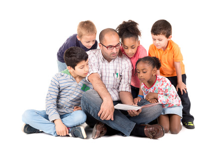 Photo pour Group of children with teacher reading a story isolated in white - image libre de droit