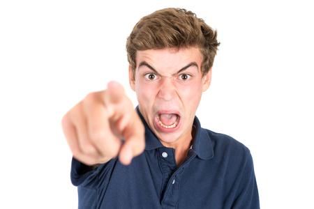 Foto de Angry teenage boy making faces isolated in white - Imagen libre de derechos