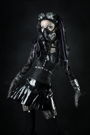 Photo pour Cyber Gothic girl posing isolated in a dark background - image libre de droit
