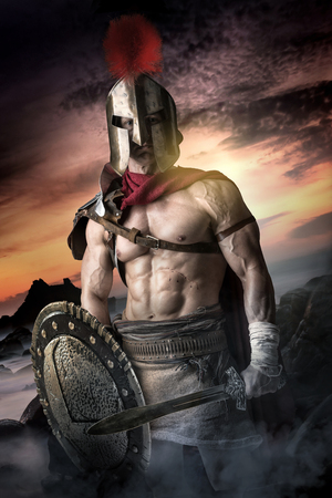Photo for Ancient warrior or Gladiator posing outdoors with helmet - Royalty Free Image