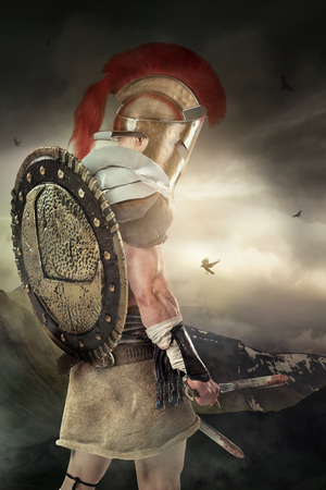 Photo for Ancient warrior or Gladiator posing with mountains in the background - Royalty Free Image
