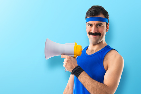 Photo for Sportman shouting by megaphone - Royalty Free Image
