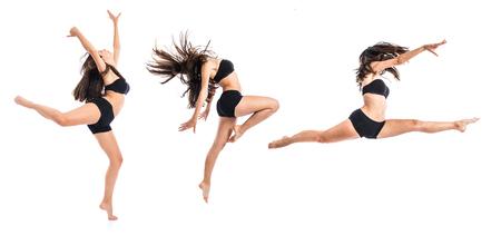 Foto de Young ballet dancer jumping over white background - Imagen libre de derechos