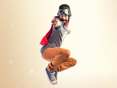 Photo pour Superhero pointing to the front - image libre de droit