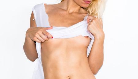 Foto de Beautiful blonde woman with wet t-shirt - Imagen libre de derechos