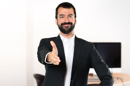 Photo for Handsome businessman making a deal in the office - Royalty Free Image