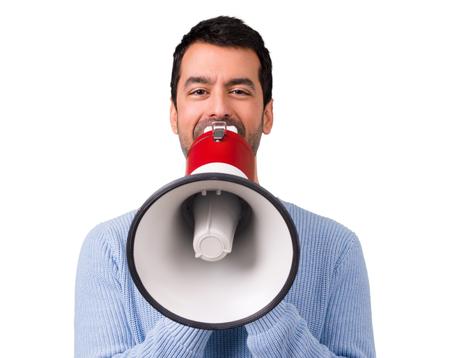 Photo pour Man with blue sweater shouting through a megaphone - image libre de droit