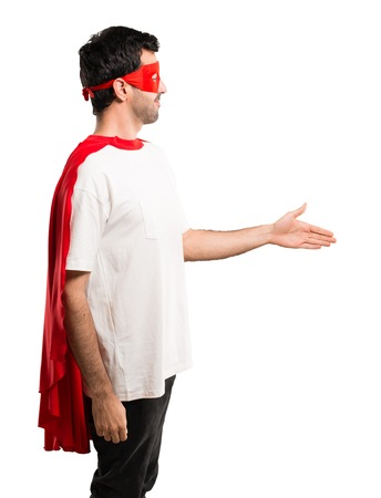 Photo for Superhero man with mask and red cape handshaking after good deal on isolated white background - Royalty Free Image
