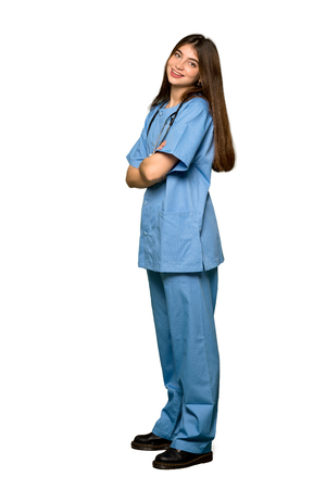 Photo pour Full-length shot of Young nurse with arms crossed and looking forward on isolated white background - image libre de droit