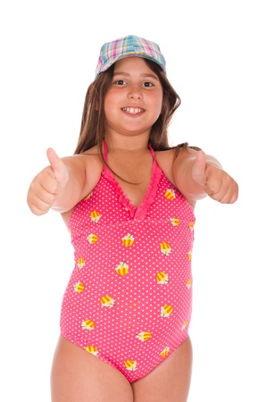 beautiful brunette teenage girl in swimsuit showing thumbs up (isolated on white background)