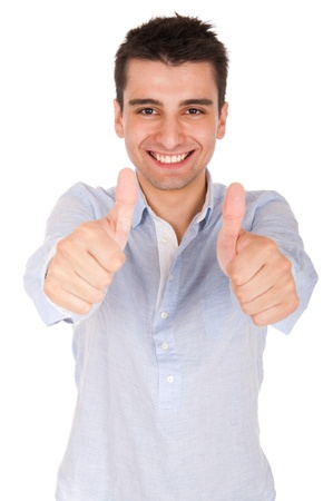 smiling young casual man showing thumbs up sign (isolated on white background)