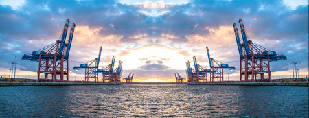 Photo for Hamburg / Germany - July 12 2017: Container gantry cranes of the terminal Eurogate getting ready for unloading ships in the deepwater port Hamburg-Waltershof - Royalty Free Image