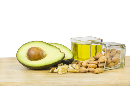 Foto de Good fats diet avocado dry fruits and oil - Imagen libre de derechos