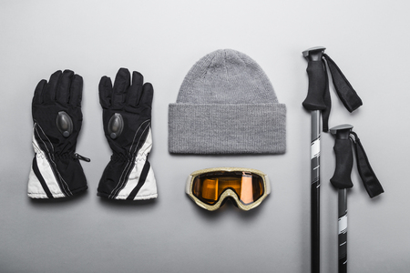 Foto de Winter sports and skiing gear, including gloves, hat, goggles and ski poles - Imagen libre de derechos