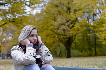 Photo pour  lonely young woman sitting on bench - image libre de droit