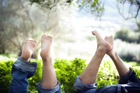 Feets up of a young  couple in love expressing relaxation and fun