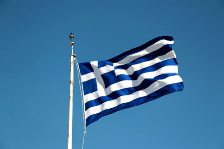 Photo for national flag of Greece against blue sky background. - Royalty Free Image