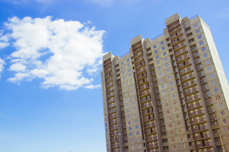 Photo for New uncompleted residential high-rise building of reinforced concrete slabs on the background of the blue sky. Social programs and affordable housing for young families. Construction industry. - Royalty Free Image
