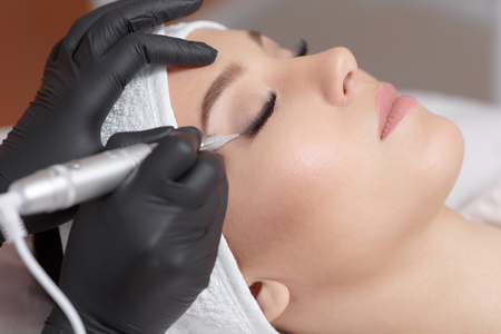 Photo for Close up cosmetologist making eyeliner permanent makeup - Royalty Free Image
