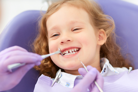Photo for Smiling girl at dentist - Royalty Free Image