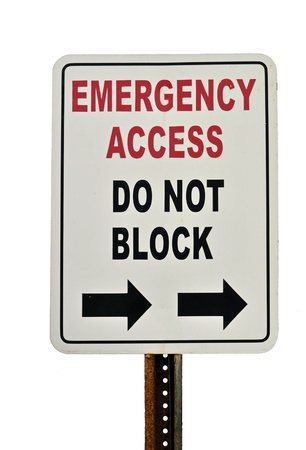 Sign reads Emergency access Do not block; isolated on white background