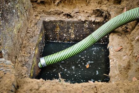 Photo pour Suction hose ready to drain the septic tank - image libre de droit