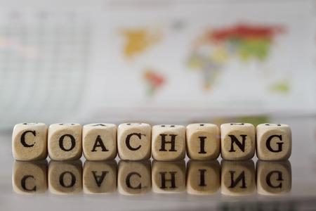 Foto de Coaching word built with letter cubes - Imagen libre de derechos