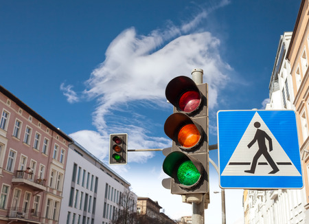 Photo for Traffic lights and pedestrian crossing sign in a city. - Royalty Free Image