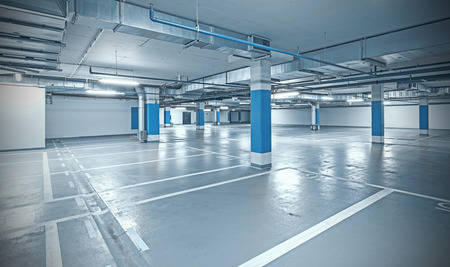 Foto de Cross processed photo of underground parking, industrial interior background. - Imagen libre de derechos