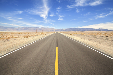 Endless country highway in Death Valley, travel adventure concept, USA.
