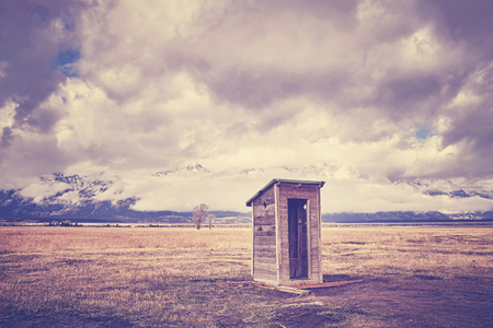 Photo for Vintage toned old wooden backcountry toilet in the Grand Teton National Park, Wyoming, USA. - Royalty Free Image