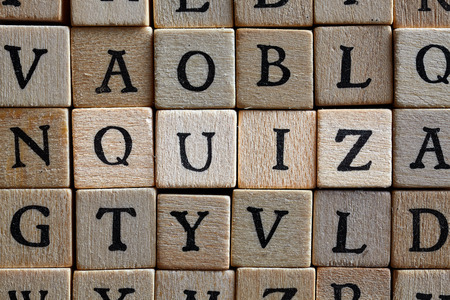 Photo for Quiz word Wooden cube block building the word QUIZ - Royalty Free Image