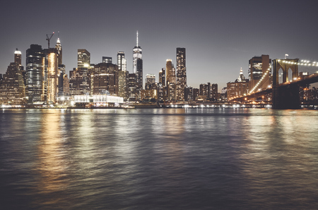 Foto de New York City skyline at night, color toned picture, USA. - Imagen libre de derechos