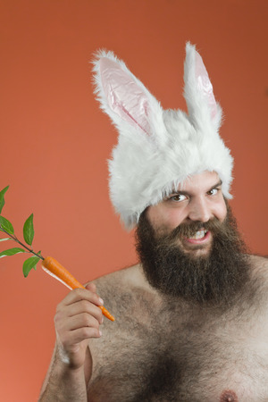 Photo for Grinning bearded fat man wears silly bunny ears - Royalty Free Image