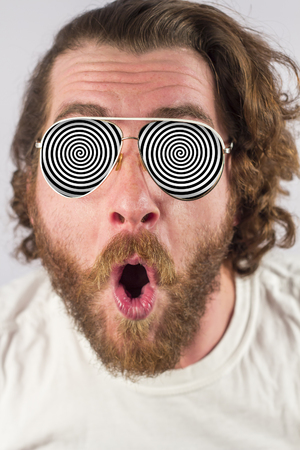 Foto de Shocked man optical illusion glasses hypnosis image - Imagen libre de derechos