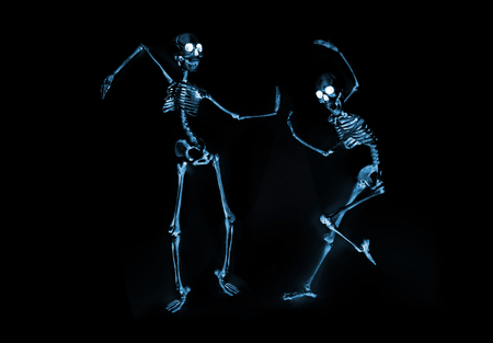 Photo pour Silly dancing skeletons as seen through an xray machine - image libre de droit