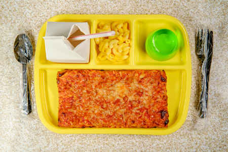 Photo pour Grade school lunch tray with pizza with small carton of milk mac-n-cheese and green jelly for dessert - image libre de droit