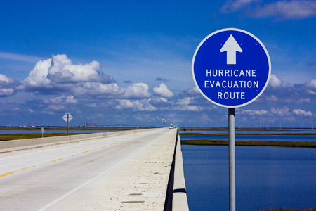 Foto de Hurricane evacuation route sign on an elevated highway above the coastal marsh - Imagen libre de derechos