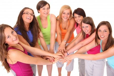 A picture of young women standing in a circle and bonding their hands