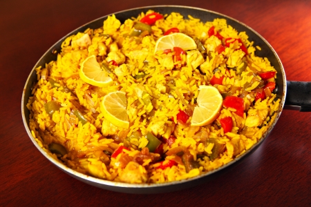 A picture of a fresh home made paella served on a frying pan