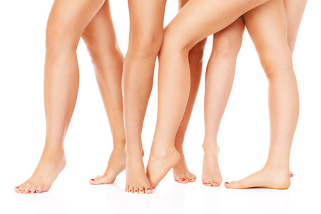 A picture of female legs over white background