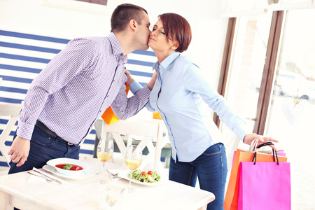 Photo pour A picture of a young couple meeting in a restaurant - image libre de droit
